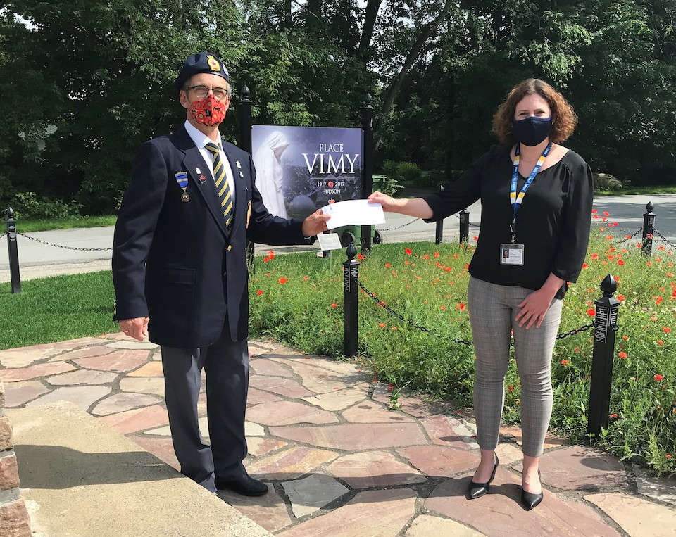 Cheque presentation at the Hudson Legion's Place Vimy cenotaph by Poppy Fund Chairman, John Dalgarno, to HGH Foundation Executive Director, Erin Tabakman.